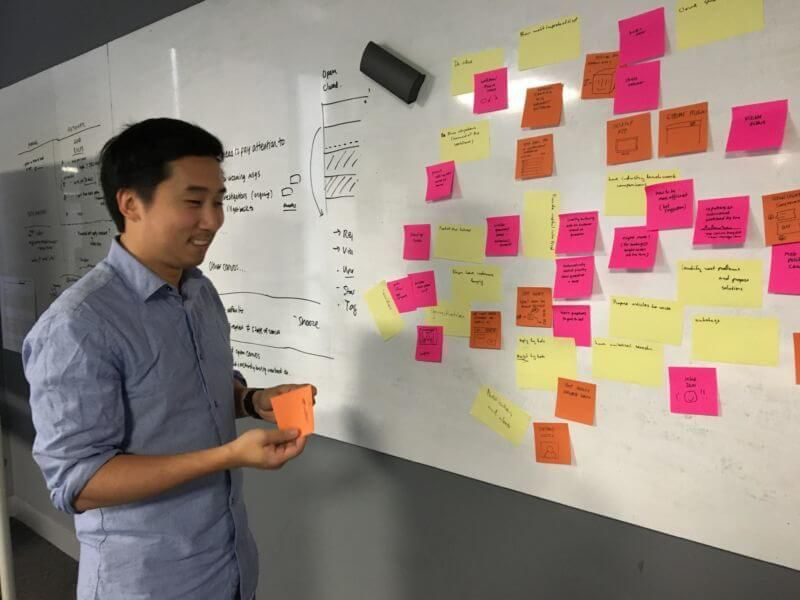 Shek, one of our designers, sharing an idea about automation in our brainstorm.